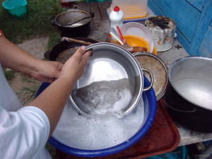 Dishes washed in basin